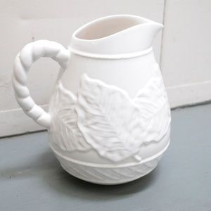 Antique watering pitcher for plants